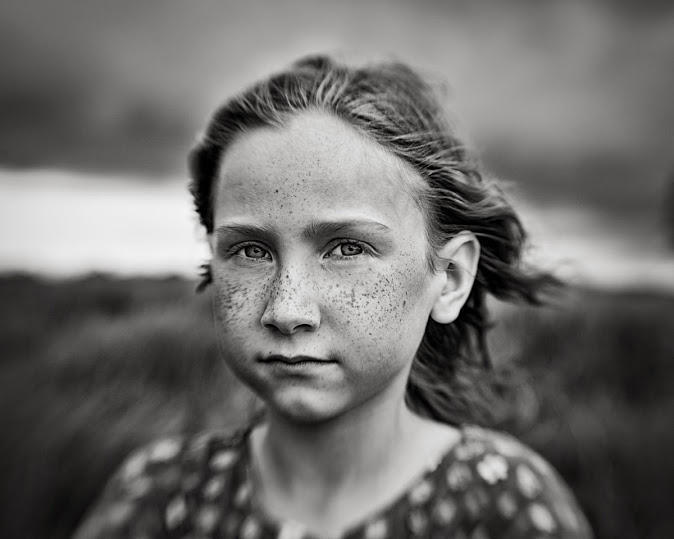 little girl with freckles