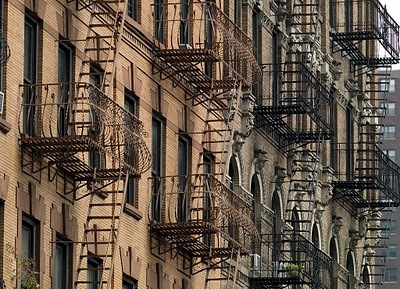 Fire escapes on brownstone New York City
